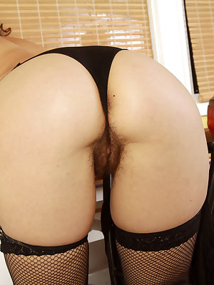 Naught middle-aged maid Sunshine exposes her hairy bush at work in the kitchen