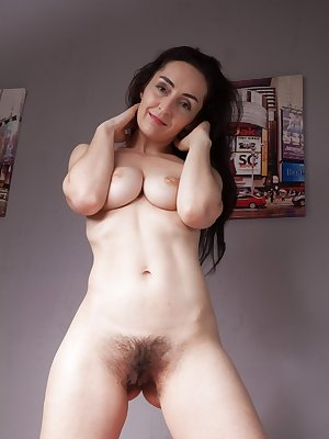 Older first timer Di Devi parts her hairy pussy wide open after disrobing