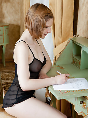 Cute Mariam in sheer lingerie exposing her hairy pussy in the writing desk