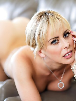 Blonde female Brandi Love flaunts her big boobs in the nude