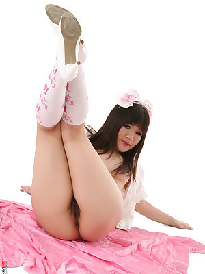 Cute Asian girl Maya Mai doffs her dress and panties for nude poses