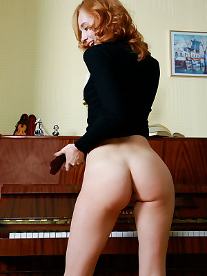 Hot redhead piano teacher strips to flash closeup shaved pussy on the bench
