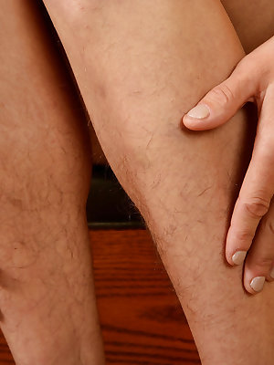 Older lady Kristina shows off her unshaven legs and vagina