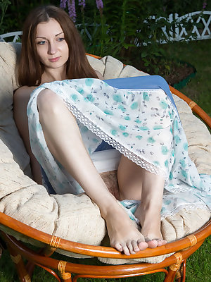 European teen Melissa Ray slips out her summer dress to pose in the nude