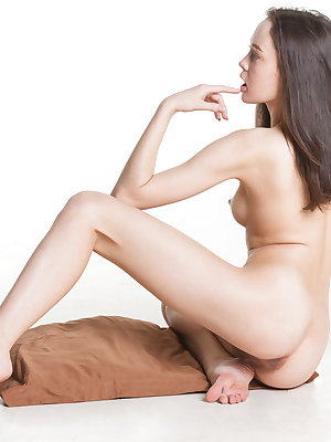 Naked young girl spreads her legs to best display her all natural pussy