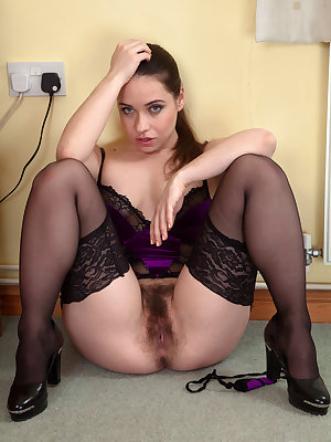 Yummy MILF in stockings Olga Cabaeva shows off her bushy cunt from all angles