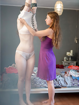 Real life dykes Emilia and Sophie caught getting dressed by voyeur