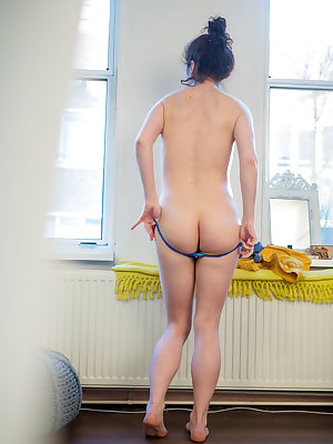 Nude amateur Livia V is secretly filmed getting dressed by a hidden camera