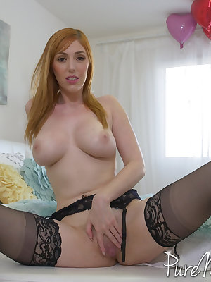 Hot redhead MILF Lauren Phillips bares her big boobs before showing her pussy