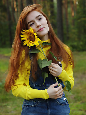 Redheaded teen girl Jia Lissa disrobes for nude posing in the woods