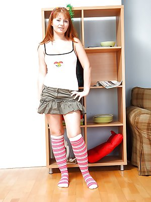 Red-haired teen Jess B takes off the skirt and fondles her hairy cunt
