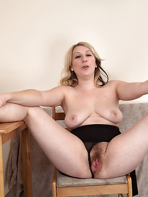 Dirty blonde older MILF Mel Harper works free of her little black dress