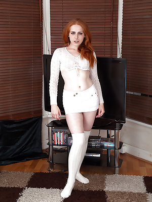 Mature redhead Tia Jones showing off hairy ginger pussy in over the knee socks