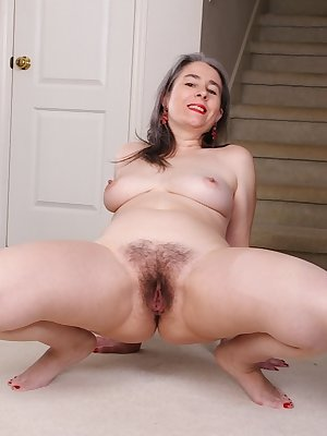 Older Euro woman Lexy Lou revealing big tits and beaver while undressing