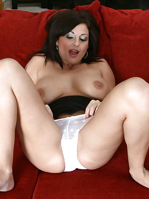 Mature brunette with big tits and nipples Lola Lynn poses in white stockings