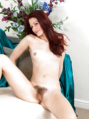 Amateur redhead Lizzie rubs her hairy pussy with both hands to achieve orgasm