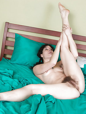 Hirsute MILF Sunshine showing off hairy legs and furry pussy