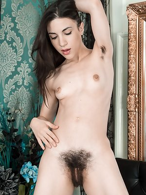 Teen Luna O unveils a soft hairy pussy under the sexy lace panties in her room