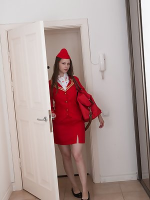 Beata is in her red flight attendant suit and looks extremely sexy. She strips and models her hairy pits and slender figure. Sitting on the floor, she plays with her hairy pussy and relaxes.