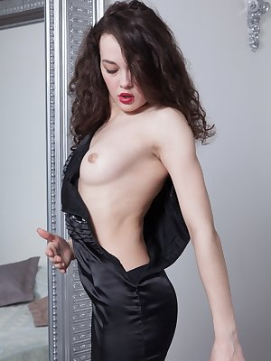 Ksenia Yankovskaya is putting on lipstick by her mirror in her black dress. She strips and undresses and lays naked on her bed. She lays back to masturbate and finger her hairy pussy till orgasming.
