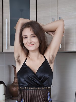Shivali is eating watermelon in her black dress. She shows off her hairy pits while enjoying it and strips naked. She rubs the melon over her body and then climbs on the counter to show more off.