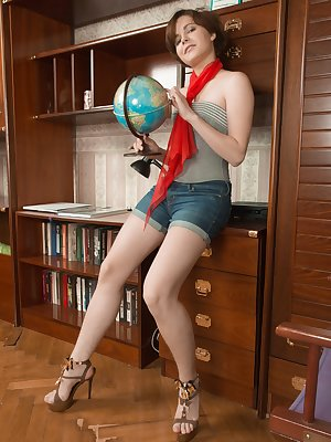 Aria is enjoying her new globe and seeing the world. She strips naked afterwards, and displays her very hairy pussy. She then lays on the floor touching her hairy pussy and masturbating with passion.