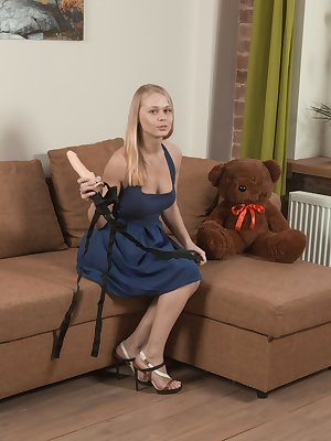 Hairy amateur Darina Nikitina affixes strapon dildo to her Teddy and rides it
