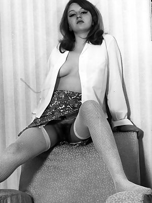 Sexy young vintage chick shows off a hairy pussy & perky tits wearing nylons