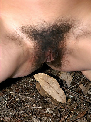 Smiling Asian babe Amanda gets outdoors and reveals hairy parts of body