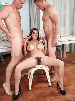 Big boobed female Mischel Lee gives 2 guys oral sex at the same time