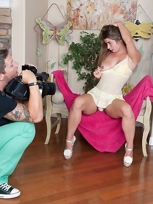 Bunny poses for her photographer before he services her beaver with his cock