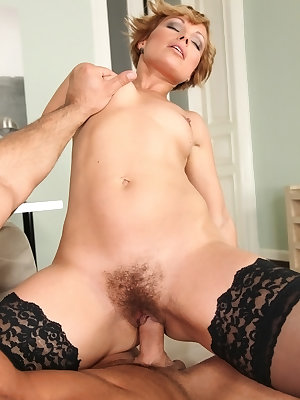 Older lady in sheer lingerie and nylons sports a creampie after office sex