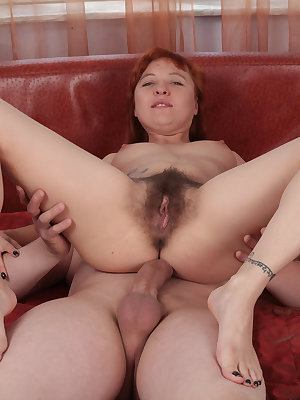 Redhead chick with unshaven underarms and vagina is stripped naked and banged