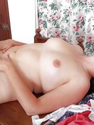 Hairy mature woman Suzanne loves having nipples and hairy pussy licked