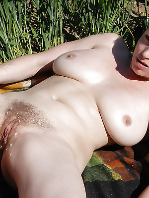 Busty amateur Carol exposing long clit outdoors while taking dick in beaver