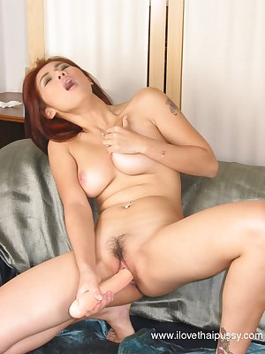 Asian redhead loves masturbating with her favorite dildo toys