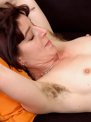 Hairy mature amateur chick grinds on cock as a cowgirl and gets cum on muff