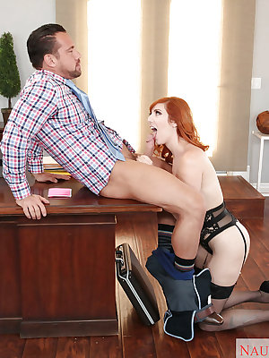 Redhead secretary Lauren Phillips giving co-worker blowjob in office