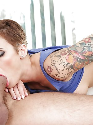 Tattooed Italian MILF Gabrielle Gucci giving a thick cock head