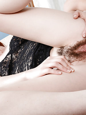 Hairy amateur Emma Evins taking a condom covered cock in her asshole