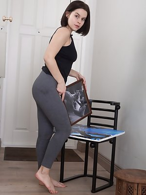 First timer Ole Nina displays her natural pussy after undressing