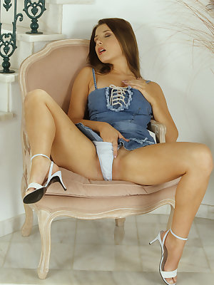 Beautiful erotic Erica A bends for sexy upskirt before masturbating her pussy