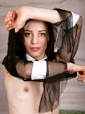 Solo model Maria Ariana slips off her nun's outfit to pose in the nude