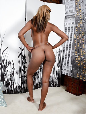 Black chick Ebony Desire slips of her halter top and shorts to pose naked