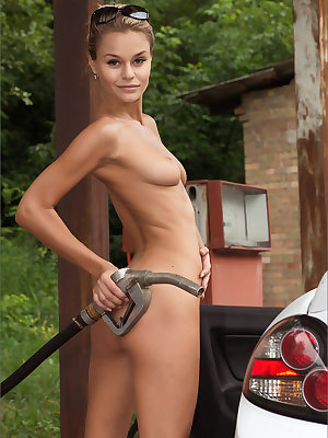 Prim looking blonde strips to gas up her car naked showing a hairy muff