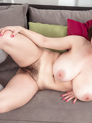 Chubby solo girl with nice melons and a hairy muff masturbates in socks