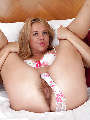 Aged lady Elle Macqueen doffing pretty panties to display her wide open beaver