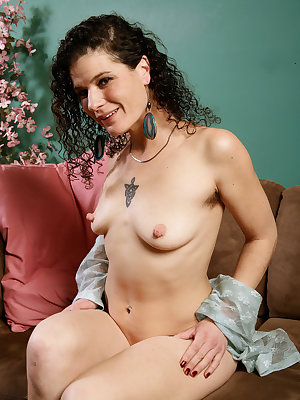 Middle-aged hirsute female Sunshine just loves to show off her hairy bush