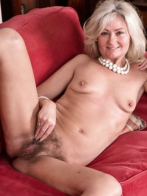 Mature blonde Ellen B removes her panties to show her incredibly hairy pussy