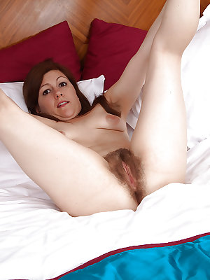 Mature solo model Lacey doffing undies for spreading of hairy vagina